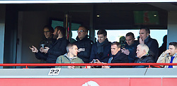 LIVERPOOL, ENGLAND - Sunday, March 8, 2015: Liverpool's captain Steven Gerrard and former player Jamie Carragher watch from an executive box during the FA Cup 6th Round Quarter-Final match against Blackburn Rovers at Anfield. (Pic by David Rawcliffe/Propaganda)