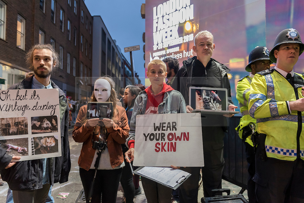 © Licensed to London News Pictures. 17/09/2016. London, UK. Animal activists and anti-fur campaigners stage a night time protest outside London Fashion Week's home in Brewer Street, Soho. Photo credit : Stephen Chung/LNP