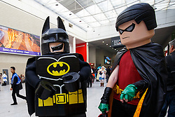 © Licensed to London News Pictures. 25/10/2015. London, UK. Cosplayers dressed as Lego Batman characters attending the MCM London Comic Con at ExCeL Convention Centre on Sunday, 25 October 2015. Photo credit: Tolga Akmen/LNP