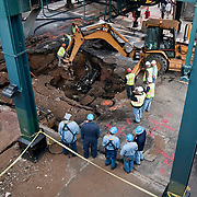 June 14, 2009 - Bronx, NY : Construction crews and emergency workers work to clean up and restore services to the intersection of Broadway and W. 231st St. where a water main broke overnight, leaving much of the community without water, and much of the neighborhood under water.  A view of the scene from atop Chase Bank at the northwest intersection of W 231st St. and Broadway.