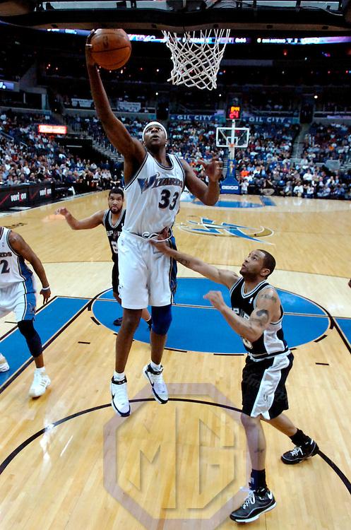 06 February 2008:   Washington Wizards center Brendan Haywood (33) scores in the 1st half against San Antonio Spurs forward Ime Udoka (5) at the Verizon Center in Washington, D.C.  The Spurs defeated the Wizards 85-77.