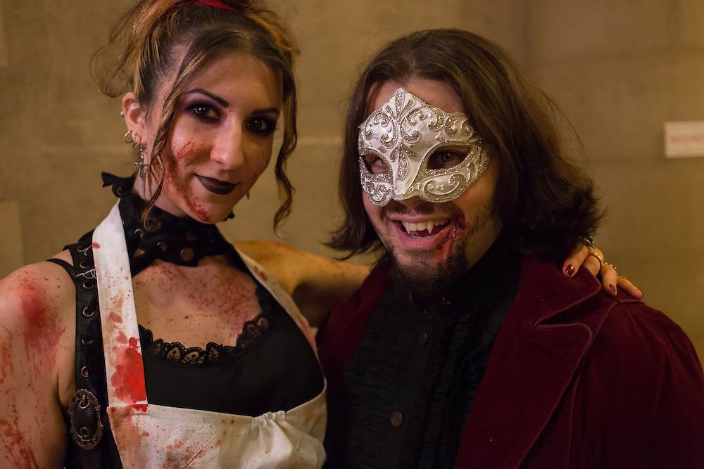 A couple with bloodied costumes.