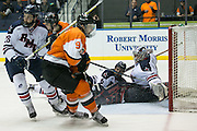 Robert Morris goaltender Terry Shafer and Robert Morris defenseman Rob Mann fall in the crease stopping an RIT shot during the Atlantic Hockey final at the Blue Cross Arena in Rochester on Saturday, March 19, 2016.