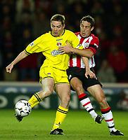 Photograph: Scott Heavey.<br />Southampton v Charlton Athletic. FA Barclaycard Premiership. 07/12/2003.<br />Matt Holland (L) and Paul Telfer fight for th ball