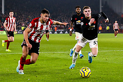 George Baldock of Sheffield United takes on Brandon Williams of Manchester United - Mandatory by-line: Robbie Stephenson/JMP - 24/11/2019 - FOOTBALL - Bramall Lane - Sheffield, England - Sheffield United v Manchester United - Premier League