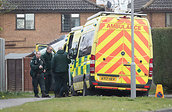 © Licensed to London News Pictures. 15/03/2018. Alderholt, UK. Ambulances standby as a military truck prepares to remove a vehicle from the village of Alderholt, south of Salisbury where former Russian spy Sergei Skripal and his daughter Yulia were poisoned with nerve agent. The couple where found unconscious on bench in Salisbury shopping centre. A policeman who went to their aid is currently recovering in hospital. Photo credit: Peter Macdiarmid/LNP