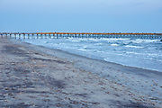 Fishing pier and ocean waves at Atlantic Beach, located along the Crystal Coast of North Carolina (note: this scene was photographed in April 2018 and the fishing pier was damaged by Hurricane Florence later that year)