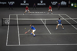 September 21, 2018 - Chicago, Illinois, U.S - Team Europe member ROGER FEDERER of Switzerland and partner NOVAK DJOKOVIC of Serbia take the net while Team World member KEVIN ANDERSON of South Africa and partner JACK SOCK of the United States stay back on the baseline during the first doubles match on Day One of the Laver Cup at the United Center in Chicago, Illinois. (Credit Image: © Shelley Lipton/ZUMA Wire)