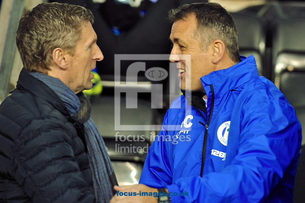 Picture by Ian Wadkins/Focus Images Ltd +44 7877 568959<br /> 28/11/2013<br /> Wigan Athletic manager Owen Coyle (right) greets Zulte Waregem manager Francky Dury ahead of the UEFA Europa League match at the DW Stadium, Wigan.