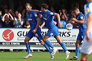 AFC Wimbledon goalkeeper Tom King (1) celebrating after scoring goal to make it 1-2 during the EFL Sky Bet League 1 match between AFC Wimbledon and Portsmouth at the Cherry Red Records Stadium, Kingston, England on 13 October 2018.