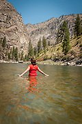 Woman enjoying the water at Elk bar in the Impassible Canyon on the Middle Fork of the Salmon River during six day rafting vacation, Idaho.