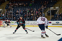 KELOWNA, CANADA - DECEMBER 5: Dalton Gally #3 of the Kelowna Rockets defends the zone as Paycen Bjorklund #29 of the Tri-City Americans takes a shot on net on December 5, 2018 at Prospera Place in Kelowna, British Columbia, Canada.  (Photo by Marissa Baecker/Shoot the Breeze)