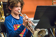 TORONTO. June 13, 2015 - A young boy practices his part on Trumpet during rehearsal.
