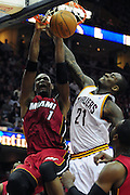 March 29, 2010; Cleveland, OH, USA; Miami Heat power forward Chris Bosh (1) dunks over Cleveland Cavaliers power forward J.J. Hickson (21) during the third quarter at Quicken Loans Arena. The Cavaliers beat the Heat 102-90. Mandatory Credit: Jason Miller-US PRESSWIRE