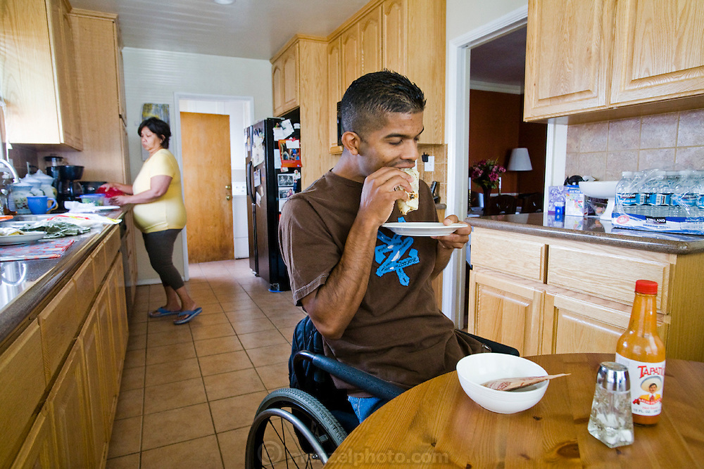 Felipe Adams, a 30-year-old Iraq war veteran who was paralyzed by a sniper's bullet in Baghdad, Iraq, eats breakfast at his parents home in Inglewood, California. (Felipe Adams is featured in the book What I Eat: Around the World in 80 Diets.) MODEL RELEASED.