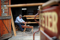 Picture By Jim Wileman  22/06/2009  Following the process of making a wooden carriage wheel, at Mike Rowland Wheelwright and coachbuilders, in Colyton, Devon. Using a spoke shave on the spoke horse.