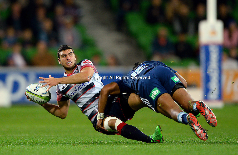 Jack Debreczeni (Rebels) tackled by Lolagi Visinia (Blues)<br /> Auckland Blues vs Melbourne Rebels<br /> Rugby Union - 2015 Investec Super Rugby <br /> AAMI Park, Melbourne Australia<br /> Friday 8th May 2015<br /> &copy; Sport the library / Jeff Crow