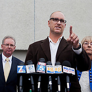 Attorney Marco Gonzalez and former City Councilwoman Donna Frye call on Mayor Bob Filner to resign at a press conference outside of Briggs Law Corporation.