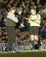 Photo: Aidan Ellis.<br /> Everton v Arsenal. The Barclays Premiership. 21/01/2006.<br /> Referee Alan Wiley asks David Moyes to Calm down