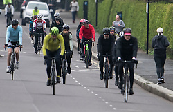 © Licensed to London News Pictures. 04/04/2020. London, UK. Cyclists exercising in close proximity around Regents Park in London, during a pandemic outbreak of the Coronavirus COVID-19 disease. The public have been told they can only leave their homes when absolutely essential, in an attempt to fight the spread of coronavirus COVID-19 disease. Photo credit: Ben Cawthra/LNP