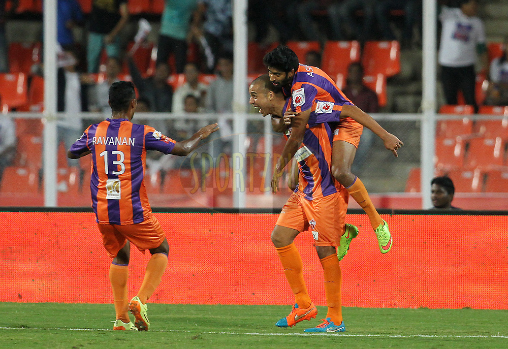 David Trezeguet of FC Pune City celebrates a goal with his teammates during match 17 of the Hero Indian Super League between FC Pune City and Kerala Blasters FC held at the Shree Shiv Chhatrapati Sports Complex Stadium, Pune, India on the 30th October 2014.<br /> <br /> Photo by:  Vipin Pawar/ ISL/ SPORTZPICS