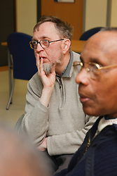 Two clients in discussion group at a resource for people with physical and sensory impairment.