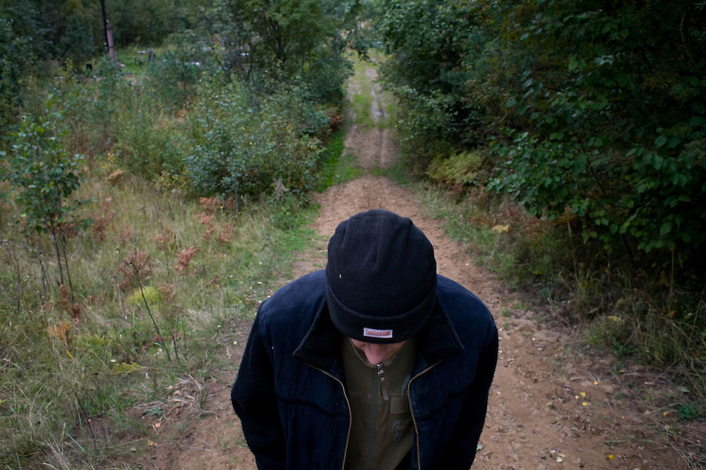 Valera, a former drug user who is now in a rehabilitation program run by the orthodox church, walks his dog near the organization's live-in retreat in Sapernoe, Russia, on Saturday, September 15, 2007. About a dozen people at a time live and work at the remote farm, about two hours from St. Petersburg, for a free one year course of treatment.