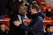 Nottingham Forest's first team coach Paul Williams shakes hands with Preston manager Simon Grayson during the Sky Bet Championship match between Nottingham Forest and Preston North End at the City Ground, Nottingham, England on 8 March 2016. Photo by Jon Hobley.