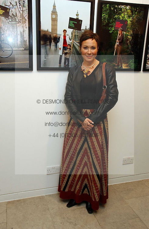 Actress AMANDA MEALING at an exhibition of photographs entitled 'Protect The Human' by photographers Jake Gavin and Sean Gleason commissioned by Amnesty Internationlal and held at The Hospital, 24 Endell Street, London WC2 on 31st May 2006.<br /><br />NON EXCLUSIVE - WORLD RIGHTS