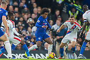 Willian (Chelsea) & James McArthur (Crystal Palace) during the Premier League match between Chelsea and Crystal Palace at Stamford Bridge, London, England on 4 November 2018.