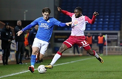 Alex Woodyard of Peterborough United in action with Emmanuel Sonupe of Stevenage - Mandatory by-line: Joe Dent/JMP - 19/11/2019 - FOOTBALL - Weston Homes Stadium - Peterborough, England - Peterborough United v Stevenage - Emirates FA Cup first round replay