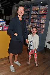 NATASHA LAW and her daughter ONDINE at a Hello Kitty Event at Liberty to lauch their collection of Hello Kitty products at Liberty, Great Marlborough Street, London on 25th September 2011.