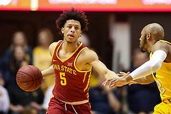 Feb 24, 2018; Morgantown, WV, USA; Iowa State Cyclones guard Lindell Wigginton (5) dribbles up the floor while defended by West Virginia Mountaineers guard Jevon Carter (2) during the first half at WVU Coliseum. Mandatory Credit: Ben Queen-USA TODAY Sports