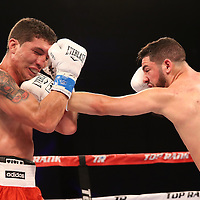 Julian Rodriguez fights Claudionel Lacerda during the Top Rank boxing event at Osceola Heritage Park in Kissimmee, Florida on September 23, 2016.