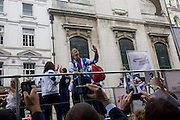London, 10th September 2012. Gold medalist paralynpic sprinter Jonnie Peacock aves to spectators, the day after the end of the London 2012 Paralympics when thousands lined the capital's streets to honour 800 of TeamGB's athletes and Paralympians. Britain's golden generation of athletes in turn said thank you to its Olympic followers, paying tribute to London and a wider Britain as up to a million people lined the streets to celebrate the ?greatest ever? sporting summer and billed to be the biggest sporting celebration ever seen in the UK.