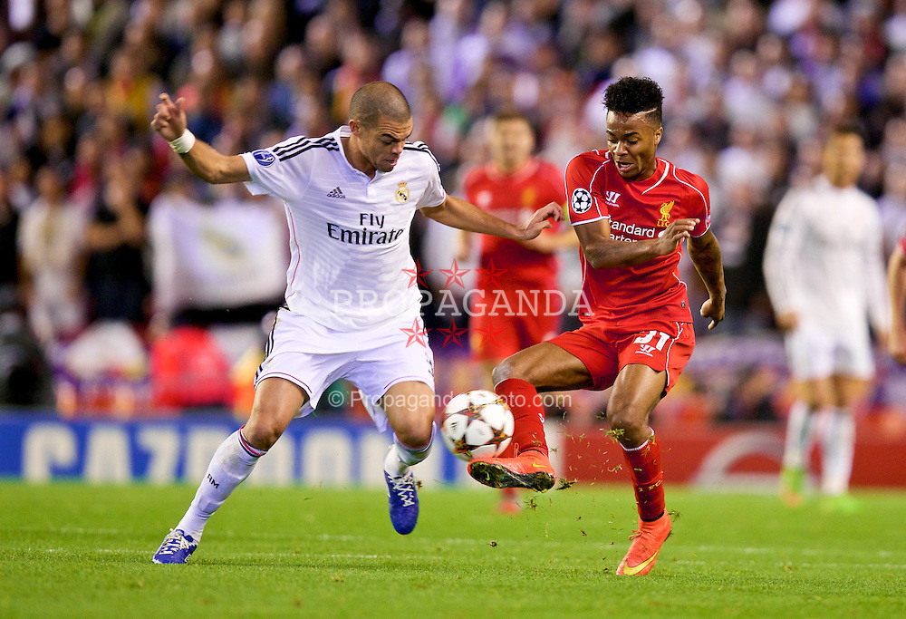 LIVERPOOL, ENGLAND - Wednesday, October 22, 2014: Liverpool's Raheem Sterling in action against Real Madrid CF's Pepe during the UEFA Champions League Group B match at Anfield. (Pic by David Rawcliffe/Propaganda)