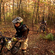 ASHEVILLE, NC - OCTOBER 28: Mountain bikers make their up a trail in the Appalachian Mountains outside Asheville in North Carolina. (Photo by Logan Mock-Bunting)