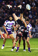 Nathan Friend goes over the top of Kenny Bromwich to pass the ball back during the NRL Rugby League match between the Vodafone Warriors and The Melbourne Storm at Mt Smart Stadium, Auckland, New Zealand. Sunday 12 July 2015. Copyright Photo: Andrew Cornaga / www.Photosport.nz