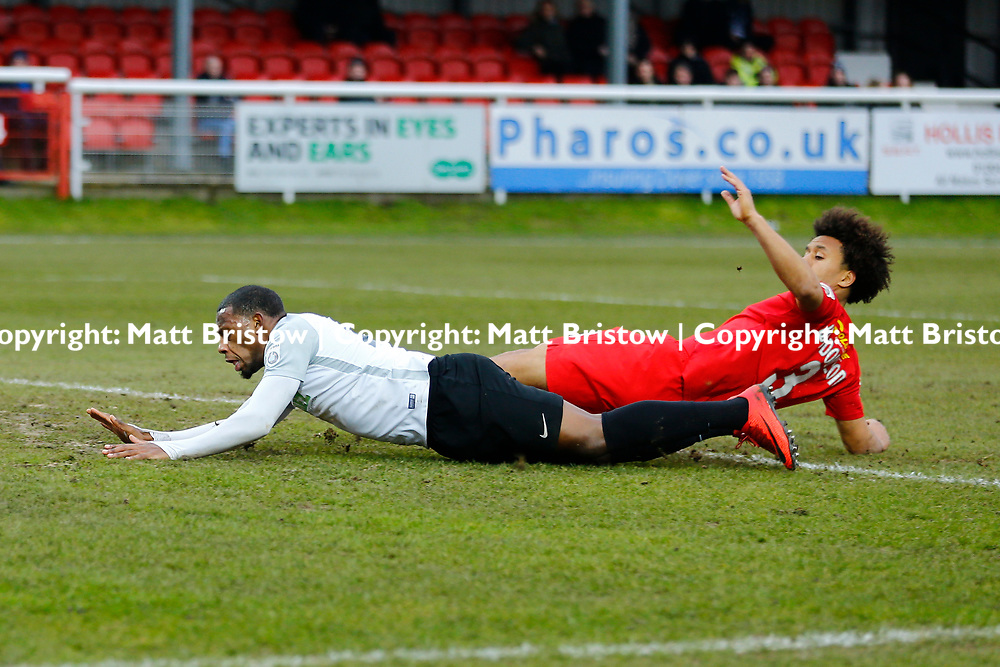 Leyton Orient's defender Joe Widdowson and Dover's forward Anthony Jeffrey collide during the The FA Trophy match between Dover Athletic and Leyton Orient at Crabble Stadium, Kent on 3 February 2018. Photo by Matt Bristow.