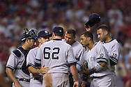 Manager Joe Torre and the Yankees infield meet with Joba Chamberlain on the mound after Chamberlain's wild pitch scored the Indians' Grady Sizemore in the eighth inning of  Game 2 of the 2007 ALDS at Jacobs Field in Cleveland. Chamberlain and the Yankees seemed bothered by a swarm of bugs that flew over the diamond.