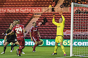 Middlesbrough FC midfielder Emilio Nsue heads the ball over the bar, watched by Nottingham Forest goalkeeper Dorus de Vries (1) during the Sky Bet Championship match between Middlesbrough and Nottingham Forest at the Riverside Stadium, Middlesbrough, England on 23 January 2016. Photo by George Ledger.