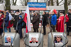 November 11, 2018 - Warsaw, Poland - Members of the National Radical Camp (ONR) and the conservative right wing associations are seen holding flags while praying next to the Polish Parliament before the official march..Days before the Independence Day, the mayor of warsaw, Hanna Gronkiewicza banned the Independence Day march organized by the extreme right wing associations while on the same day, the Polish government announced a state march that would depart from the same place as they banned the Independence Day march. On November 09th The Polish government and the organizers of the march of nationalists agreed to hold a joint march on Poland's Independence Day. (Credit Image: © Omar Marques/SOPA Images via ZUMA Wire)