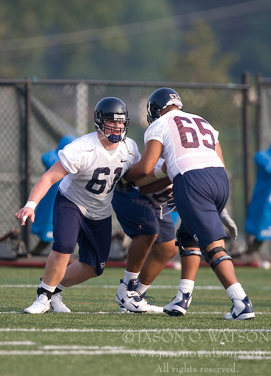 Will Barker (61)..The 2007 Virginia Cavaliers football team opened fall practice on August 6, 2007 at the University of Virginia football practice fields near the McCue Center in Charlottesville, VA.