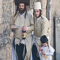JERUSALEM - MARS 09 : Ultra Orthodox family during Purim in Mea Shearim Jerusalem on Mars 09 2012 , Purim is a Jewish holiday celebrates the salvation of the jews from jenocide in ancient Persia.