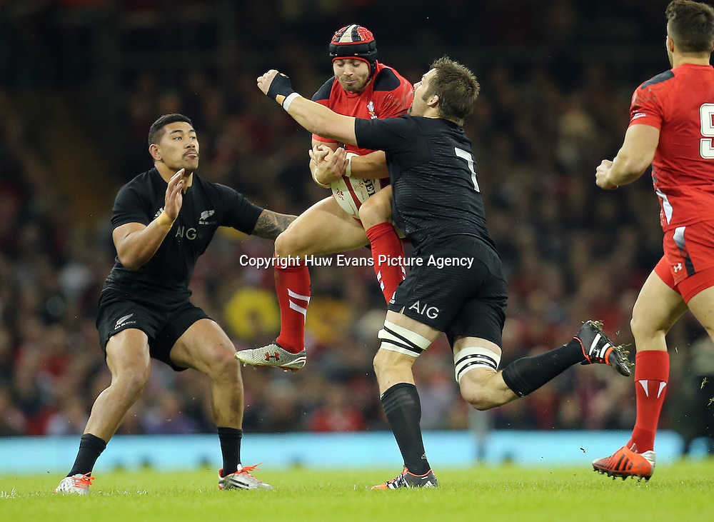 22.11.14 -  Wales v New Zealand, Dove Men Series 2014, Cardiff - <br /> Leigh Halfpenny of Wales is held by Richie McCaw of New Zealand<br /> &copy; Huw Evans Agency, Cardiff