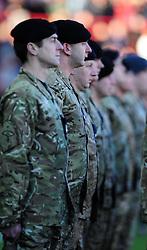 the second Royal Tank Regiment from Tidworth barracks lead the teams out on remembrance day  - Photo mandatory by-line: Joe Meredith/JMP  - Tel: Mobile:07966 386802 11/11/2012 - Bristol City v Charlton Athletic - SPORT - FOOTBALL - Championship -  Bristol  - Ashton Gate Stadium -