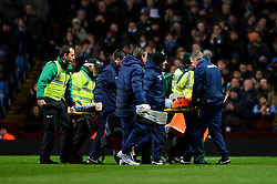 Aston Villa Defender Nathan Baker (ENG) is carried off on a stretcher with an apparent heads the ball injury during the first half of the match - Photo mandatory by-line: Rogan Thomson/JMP - Tel: Mobile: 07966 386802 - 13/01/2014 - SPORT - FOOTBALL - Villa Park, Birmingham - Aston Villa v Arsenal  - Barclays Premier League.