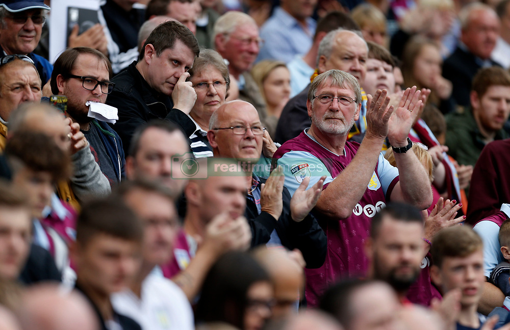 An Aston Villa fan during a minutes applause before the Graham Taylor tribute match at Villa Park, Birmingham.