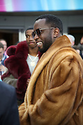 Sean John Combs, known professionally as P. Diddy,  smiles as he makes a visit to the field level before the Philadelphia Eagles 2018 NFL Super Bowl LII football game against the New England Patriots on Sunday, Feb. 4, 2018 in Minneapolis. The Eagles won the game 41-33. (©Paul Anthony Spinelli)