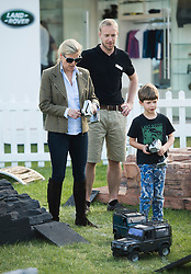 © London News Pictures. 15/05/2014. Sophie, Countess of Wessex playing with her son James on remote control Land Rovers on day two of the Royal Windsor Horse Show. Sophie, Countess of Wessex and her son also enjoyed a test ride in a full size Land Rover together.. Photo credit: Ben Cawthra/LNP